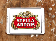 Stella artois beer logo. Logo of beer drinks company stella artois on samsung tablet on wooden background Stock Photography
