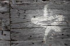 Stella bianca dipinta sul vecchio Fotografia Stock