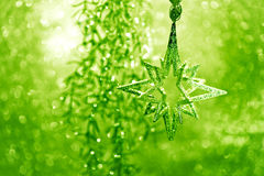 Stella d'argento lucida con gli indicatori luminosi verdi Fotografia Stock