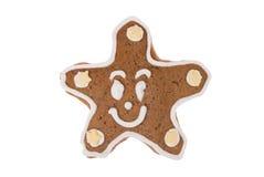 Stella del pan di zenzero di Natale isolata su un fondo bianco Fotografia Stock Libera da Diritti