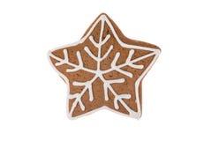 Stella del pan di zenzero di Natale isolata su un fondo bianco Immagini Stock