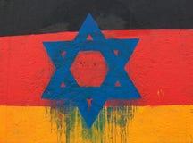 Stella di Davide su una bandiera tedesca Fotografie Stock