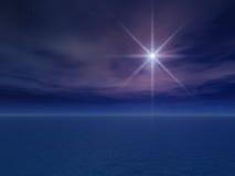 Stella di notte sopra il mare Fotografia Stock