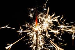Stella filante bruciante isolata sulla sfuocatura nera del fondo Immagini Stock Libere da Diritti