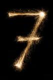Stella filante numero sette della fonte del nuovo anno su fondo nero Fotografia Stock