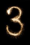 Stella filante numero tre della fonte del nuovo anno su fondo nero Immagine Stock Libera da Diritti