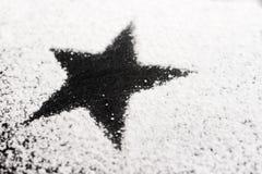 Stella nera fatta di zucchero Fotografie Stock