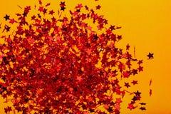 Stella rossa sul fondo dell'oro fotografie stock libere da diritti