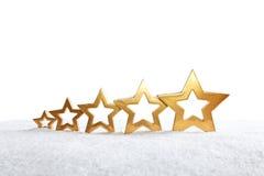 5 stelle in aumento bianche come la neve Fotografie Stock Libere da Diritti