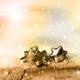 Stelle d'argento e dorate di Natale Fotografia Stock
