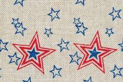 Stelle rosse e blu di U.S.A. su tela da imballaggio Fotografia Stock
