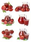 Stellen Sie Krug, Glas Tomatensaft und Früchte ein stockfotografie