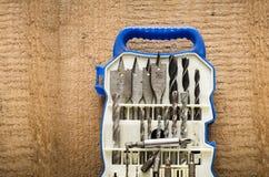 Stellen Sie vom Bohrgerätwerkzeug und -düsen auf dem Schraubenzieher mit Kopienraum ein stockbilder