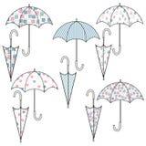 Stellen Sie von den Regenschirmen mit verschiedenen netten Mustern ein Fische in einem Baum stock abbildung