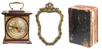 Stellen Sie von den schönen antiken Einzelteilen, von der antiken Uhr, vom goldenen Rahmen und vom schäbigen alten Buch ein stockfotografie