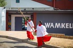 African girl from church with a cross in Kayamandi township. STELLENBOSCH, SOUTH AFRICA - NOVEMBER, 2018: African girl from church with a cross in Kayamandi stock photos