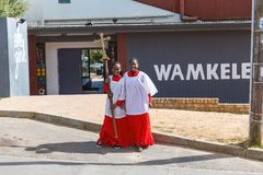 African girls from church with a cross in Kayamandi township. STELLENBOSCH, SOUTH AFRICA - NOVEMBER, 2018: African girls from church with a cross in Kayamandi royalty free stock photos