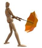 Stellende houten mannequin met paraplu. Stock Foto