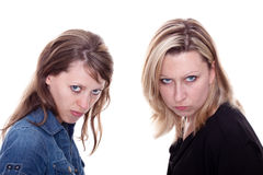 Stellt verärgerte Frau zwei den Projektor gegenüber Stockfotografie