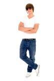Stellung des jungen Mannes lizenzfreies stockfoto