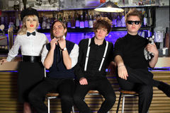Stelt populaire popgroep vier in zwart-wit Stock Afbeeldingen