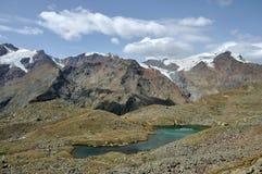 Stelvio park, lake and glacier royalty free stock photo