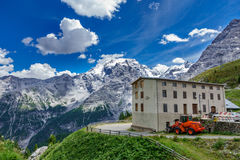 Stelvio refuge and snow over the mountains. Summer view of Stelvio refuge and snow over the mountains Royalty Free Stock Images