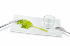 Stem of celery and glass of water Royalty Free Stock Images