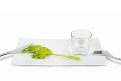 Stem of celery and glass of water Stock Photos