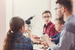 Stem education. Physical experiments at school. Physical experiments at school, kids constructing atom model on lab workplace, copy space. Stem education. Early Royalty Free Stock Image