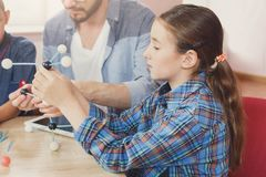 Stem education. Physical experiments at school. Physical experiments at school, kids constructing atom model on lab workplace, copy space. Stem education. Early Royalty Free Stock Photos