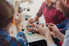 Stem education. Physical experiments at school. Kids constructing atom model on lab workplace, copy space Royalty Free Stock Image
