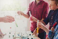 Pupils doing biochemistry research, stem education royalty free stock photos