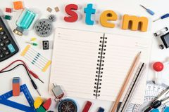Science Technology Engineering Mathematics. STEM word on book with education equipment for background. STEM Education. Science Technology Engineering stock photography