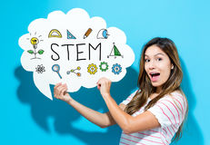 STEM text with young woman holding a speech bubble. On a blue background Stock Images