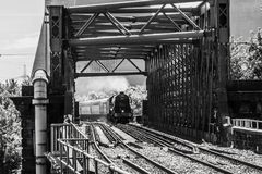 Steam train crossing bridge Stock Images