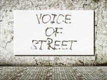 Stem van straat, woorden op muur Stock Foto