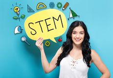 STEM with woman holding a speech bubble Stock Photo