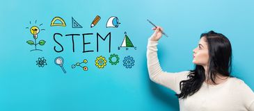 STEM with young woman holding a pen Stock Photos