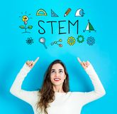 STEM with young woman looking upwards Stock Images