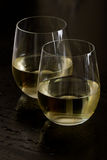 Stemless white wine glasses Royalty Free Stock Image