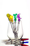 Stemless wineglass. Filled with fancy plastic forks isolated on white stock photography