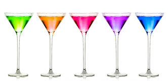 Stemmed cocktail glasses. Colorful Set of Exotic Liquors Royalty Free Stock Images