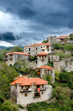 Stemnitsa village.Greece. Traditional stone made houses in Stemnitsa village under a dramatic sky.Greece Royalty Free Stock Image