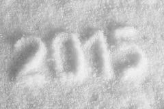 Stempel des abgehobenen Betrages 2015 auf Schnee, Platz für Text Stockfotografie