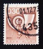 Stempel gedruckt durch Jugoslawien, Shows Posthorn, circa 1973 Lizenzfreies Stockfoto