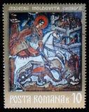 Stempel gedruckt im Rumänien, Shows ein Fresko von St George, Moldovita-Kloster Lizenzfreie Stockfotografie