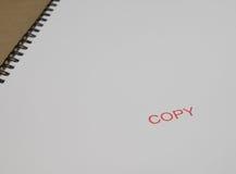 Stempelkopie auf Weißbuch Lizenzfreie Stockfotografie