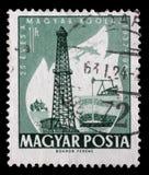 Stempluje drukowanego w Węgry dedykował 25 rocznica eksploatacja olej Fotografia Stock