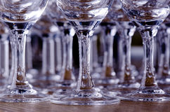 Stems of wine glasses. Sparkling transparent stems and bottom of wine glasses Royalty Free Stock Photos